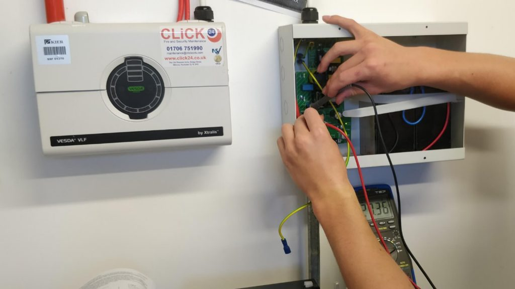 One of our engineers fixing an alarm system.