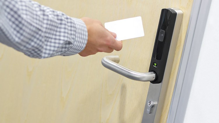 Click 24's access control door using a card